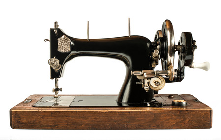 Vintage sewing machine white isolated photo