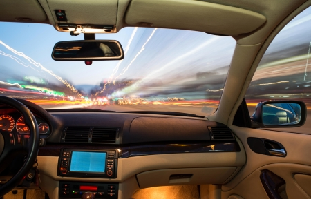 Car interior on driving. Blurred night lights 스톡 콘텐츠