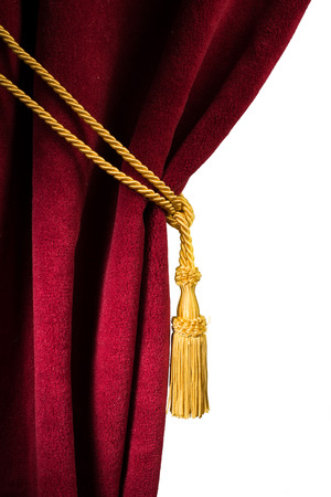 Red velvet curtain with tassel. Close up white isolated curtain 스톡 콘텐츠