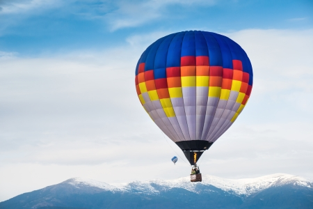 blue cloudy sky: Multicolored Balloon in the blue cloudy sky Stock Photo