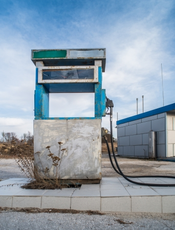 abandoned gas station: Vintage old gas pump on blue sky Stock Photo