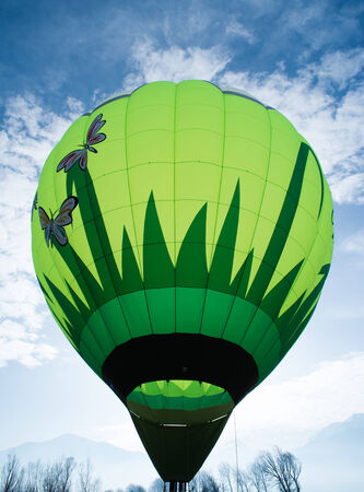 Green Balloon on blue sky photo