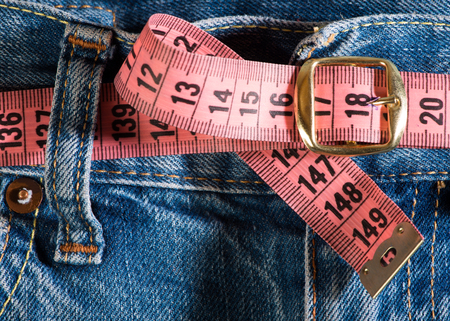 weight loss plan: Jeans and centimeter. Belt with buckle Stock Photo
