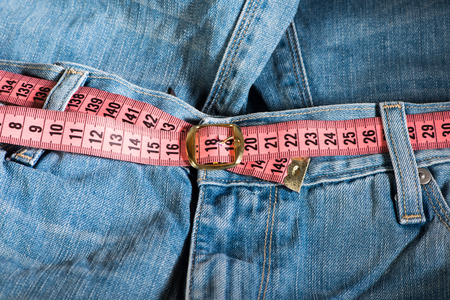 Jeans and centimeter. Belt with buckle photo