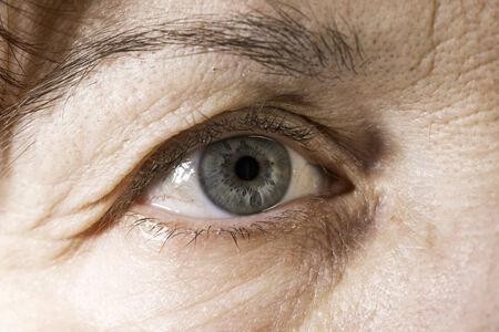 eyes close up: Close up old women blue eye Stock Photo