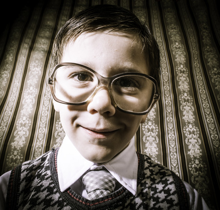 Smiling child with glasses in vintage clothes. Close up shot Stock Photo - 26312644