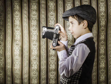 Boy with vintage camera. Vintage clothes Stock Photo - 26312645