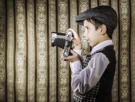 Boy with vintage camera. Vintage clothes Stock Photo - 26312645