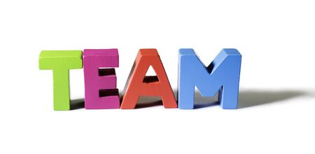 Multicolored text team made of wood. White background photo