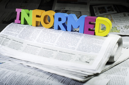 informed: Word informed on newspaper. Wooden letters Stock Photo