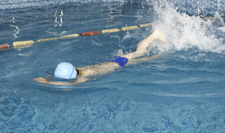 Child swimmer in swimming pool Stock Photo - 28224524