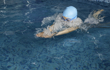 Child swimmer in swimming pool Stock Photo - 28224529