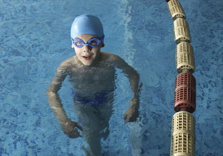 Little boy in swimming pool. Blue swimming pool. Stock Photo - 28224537