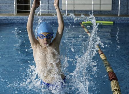 Boy jump in swimming pool Stock Photo - 28224543