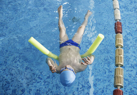 Child swimmer in swimming pool. Blue color swimming pool Stock Photo - 28634670