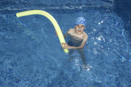 Little boy in swimming pool. Blue swimming pool. Stock Photo - 28634676