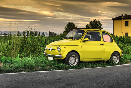 Small vintage car. Yellow color photo