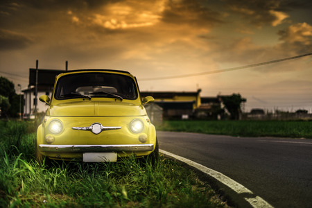 Small vintage car. Yellow color