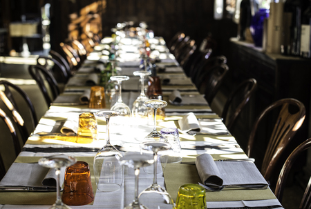 Table in an Italian restaurant. Wooden antique furniture photo