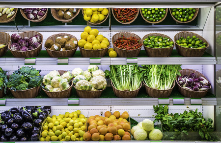 vegetables supermarket: Fruits and vegetables on a supermarket shelf. Stock Photo