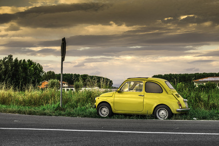 Small car. Yellow color 스톡 콘텐츠