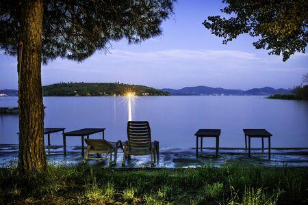 Morning on the shore of a mountain lake. Sunrise photo