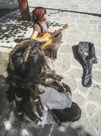 Street musicians playing guitar and drum photo