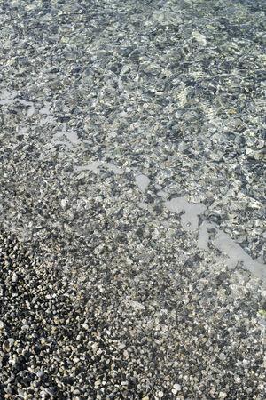 pebbles: Pebbles beach. Sea waves Stock Photo