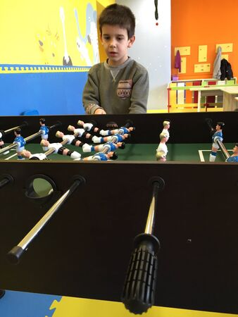 foosball: Child play foosball in playground Stock Photo
