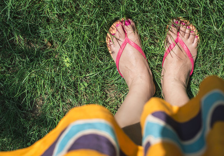 feet relaxing: Feet on green meadow. Day light, Bulgaria