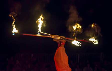 juggler: Juggler in the circus juggling with fire Stock Photo