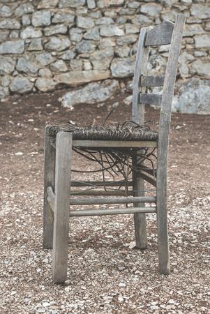 taverna: Vintage greek chair and a tree. Greece