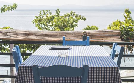 taverna: Chair in greek taverna on a beach. Greece Stock Photo