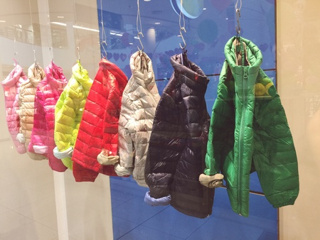 clothes: Multicolored kids jackets on a showcase