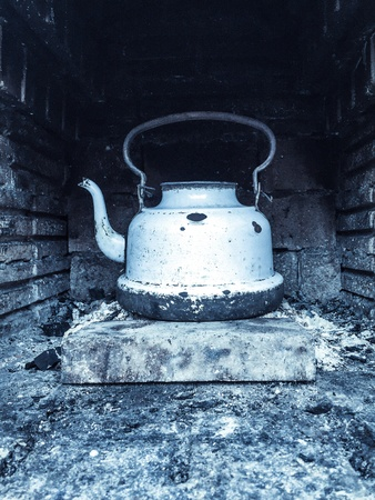 firebox: Old white battered kettle in a firebox Stock Photo