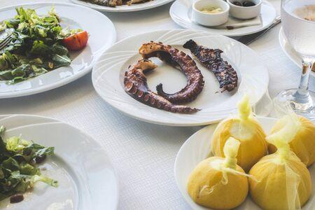 Octopus in a Greek restaurant. White table. Greece, Athens, Piraeus photo