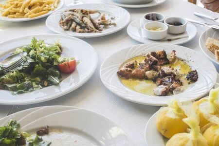 Octopus in a Greek restaurant. White table. Greece, Athens, Piraeus photo