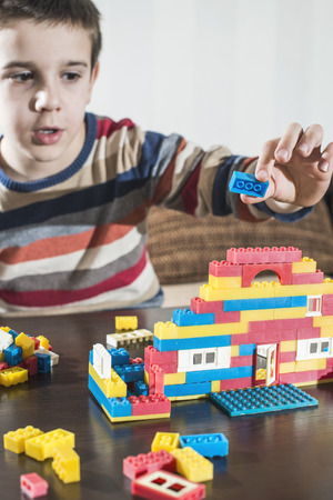 block: Child play with childrens plastic constructor toys Stock Photo