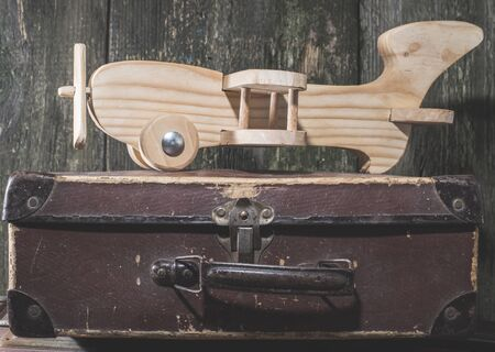 Childrens toy wooden airplane. Vintage style. photo