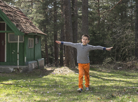 kids playing outside: Child play in the forest.