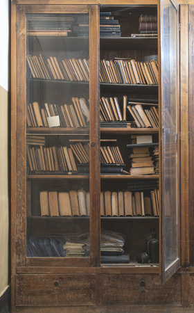 shelfs: Old books in a vintage library shelfs