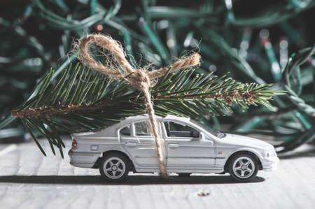 Christmas tree on car. Small toy car photo