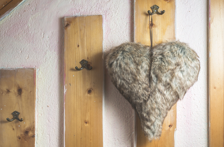 Heart shape leather on the wall photo