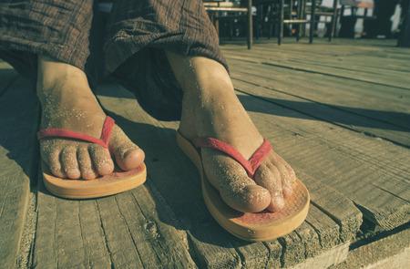 thongs: Foot in thongs on the beach