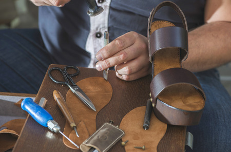 outsole: Making shoes manual. Leather sandals