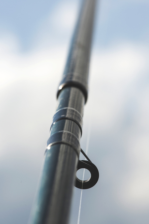 fishhook: Fishhook details. Blue sky. Daily light