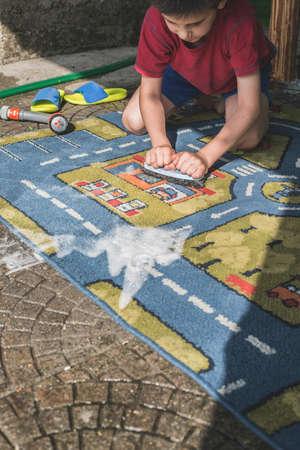 clean carpet: Child clean carpet. Exterior shot