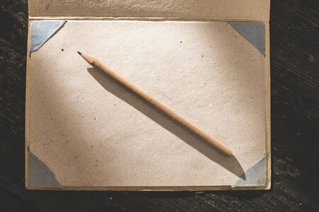 antique books: Vintage pencil and drawing paper. Weak sunlight Stock Photo