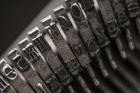 metal letters: Metal letters on typewriter. Close up macro