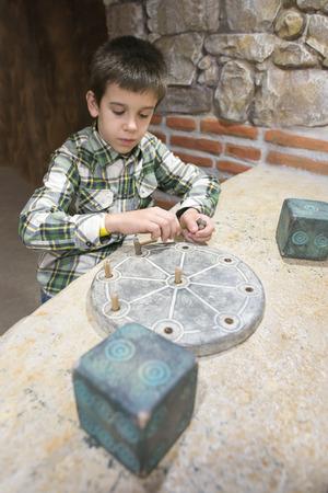 Child is archaeologist. Banco de Imagens